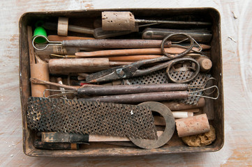 Vintage style tools in a retro tin tool box
