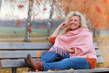 Matured woman in autumn