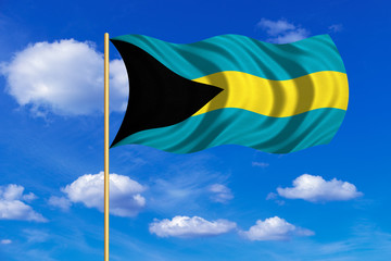 Flag of Bahamas waving on blue sky background