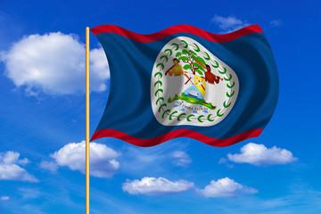 Flag of Belize waving on blue sky background