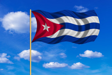 Flag of Cuba waving on blue sky background
