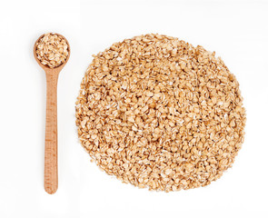 Wooden spoon and pile of oats on white background. Healthy food. Close up, top view, high resolution product.