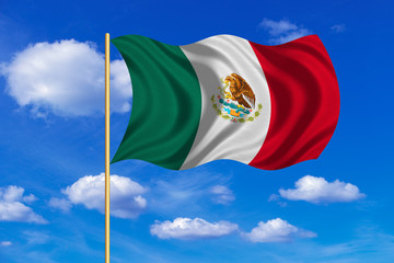 Flag of Mexico waving on blue sky background