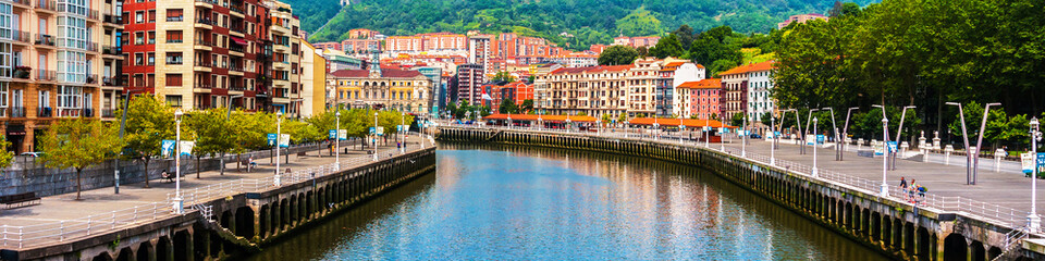 Bilbao city downtown with a River Wall mural