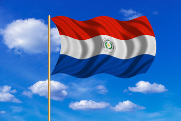 Flag of Paraguay waving on blue sky background
