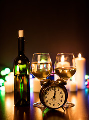 Two glasses of wine and alarm clock