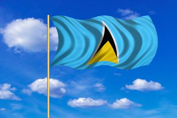Flag of Saint Lucia waving on blue sky background
