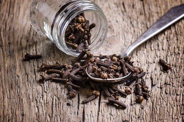 Cloves, old wooden background, selective focus