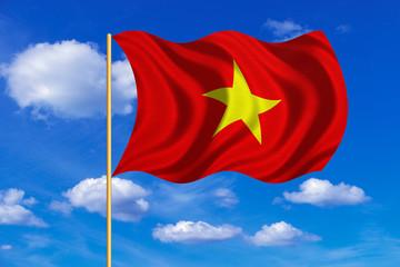 Flag of Vietnam waving on blue sky background