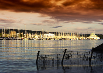 Sunset Oslo yacht club near coast background