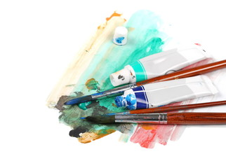 brush, tubes of paint and scratch isolated on white
