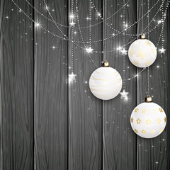 White Christmas balls on black wooden background