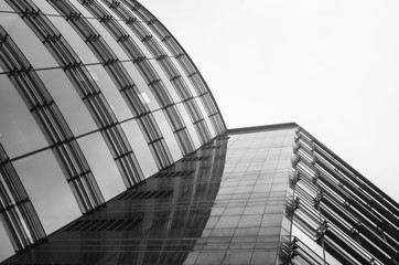 Business centre abstract architecture glass perspective view. Sky background. Black and white.