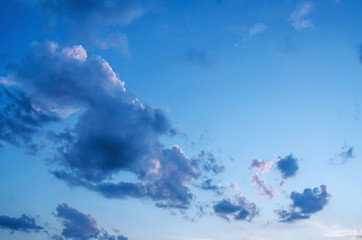 Abstract blue sky, yellow, red, orange clouds empty background