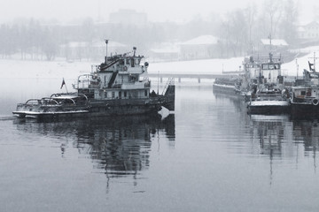 Tug boat on the river in the snow. Russia. Volga river. Winter.