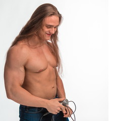 singer bodybuilder shirtless with long hair with a microphone on a white background