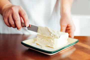 Woman preparing butter for Christmas Cookies