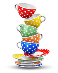 Stack of flying color polka dot coffee cups
