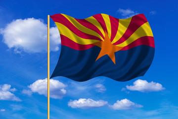 Flag of Arizona waving on blue sky background