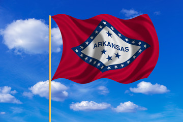 Flag of Arkansas waving on blue sky background