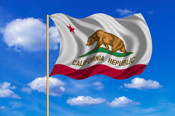 Flag of California waving on blue sky background