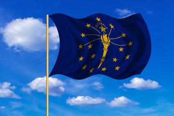 Flag of Indiana waving on blue sky background