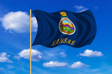 Flag of Kansas waving on blue sky background