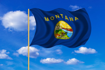 Flag of Montana waving on blue sky background
