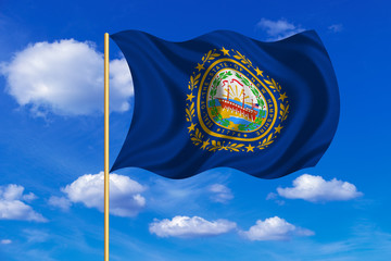 Flag of New Hampshire waving on blue sky backdrop