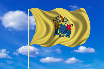 Flag of New Jersey waving on blue sky background