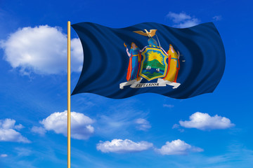 Flag of New York state waving on blue sky backdrop