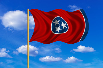 Flag of Tennessee waving on blue sky background
