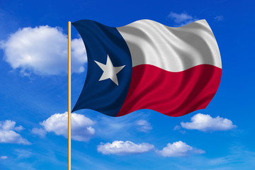 Flag of Texas waving on blue sky background