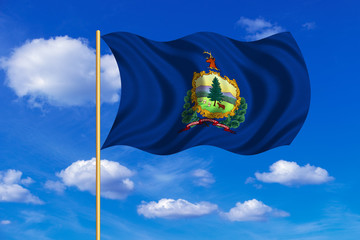 Flag of Vermont waving on blue sky background