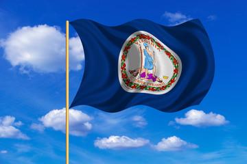 Flag of Virginia waving on blue sky background