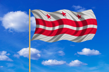 Flag of Washington, D.C. wavy on blue sky backdrop
