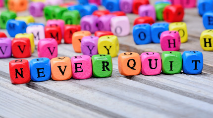 Never quit words on table