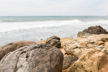 Boulders with an ocean background on a cloudy day at the Point Loma tide pools in San Diego, California.