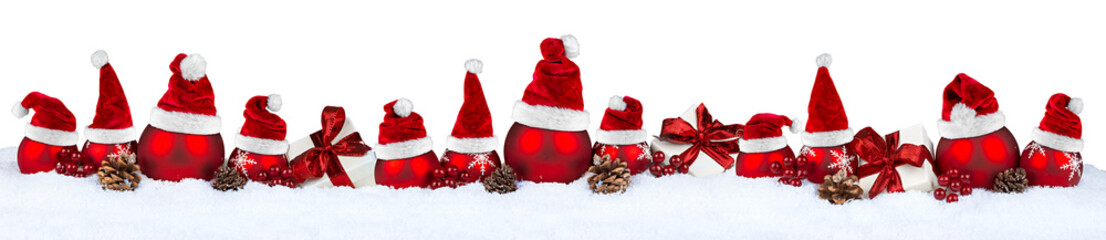 row of red christmas baubles balls in snow with santa claus hats isolated on white background