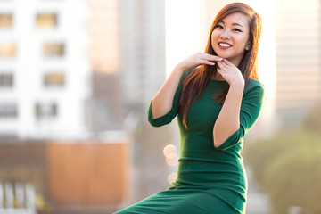 Cute fun adorable travel portrait of quirky pretty casual asian girl next door smiling laughing posing