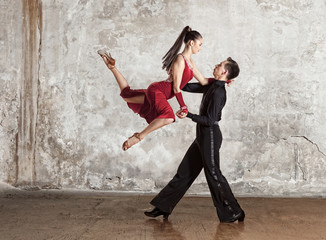 Beautiful couple in the active ballroom dance on wall