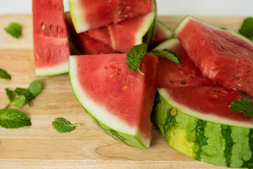 The water-melon cut on pieces, the fresh water-melon strewed listiky mints, healthy nutrition