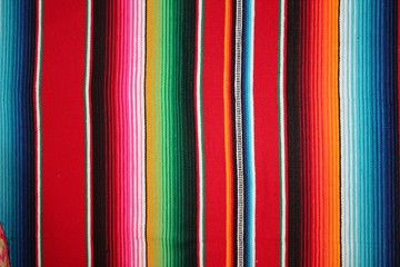 Poncho Mexican background Mexico cinco de mayo rug  serape fiesta with stripes blanket pattern copy space stock photo, stock photograph, image, picture,  Wall mural