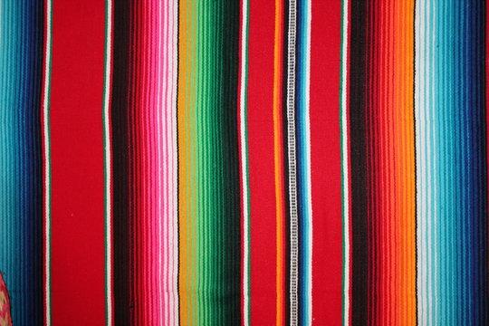 Poncho Mexican serape background Mexico cinco de mayo rug blanket serape fiesta with stripes blanket pattern Mexican copy space stock photo, stock cinco de mayo photograph