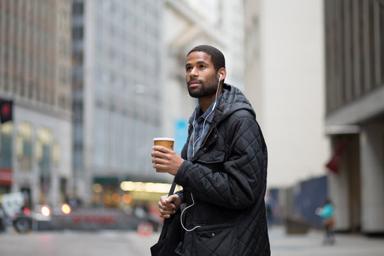 Young African American professional walking to work in the city
