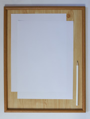 White blank paper with pencil in wood frame.