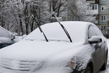 car in a winter morning with snow covered