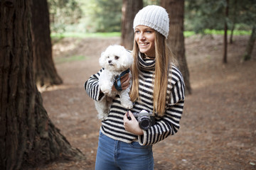 Young female with dog in woods