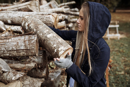 Woman putting wood