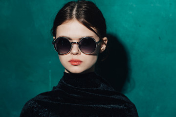 young, stylish woman in glasses, fashion background